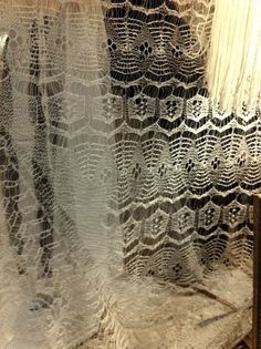 Wedding Ring Shawls from the Shetland Islands - so fine, you can pull it though a wedding ring!