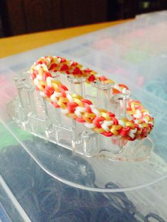Rainbow Loom Inverted Fishtail bracelet using the Monster Tail White Red opaque Gold metallic bands