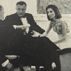 At another party, entirely, in another country, but in the same year, 1965, Gianni Agnelli and (Princess) Lee Radziwill discuss the price of mussels and beer with Comte de Mohl at the Banque Lambert, Brussels. Vogue's Notebook.