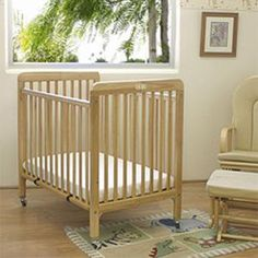 """L.A. Baby CW883 Natural 24"""" x 38"""" Folding Wood Crib with 3"""" Vinyl Covered Mattress"""
