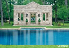 French stones from the 18th century make up this stately poolside structure. See more gorgeous pool areas.