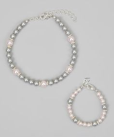 Shimmery and delicate, this oh-so-elegant bracelet set is the perfect way for Mom and a little one to show their love for one another. Boasting some precious pearls for a classy look, it will become a cherished keepsake that's sure to be worn with pride for years.