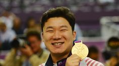 Gold medallist Jongoh Jin of Korea celebrates during the Victory Ceremony for the Men's 10m Air Pistol Shooting Final on Day 1 of the London 2012 Olympic Games at The Royal Artillery Barracks on 28 July.