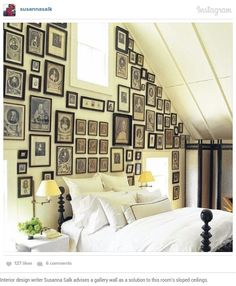 Interior design writer Susanna Salk advises a gallery wall as a solution to this room's sloped ceilings.