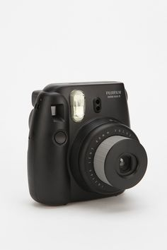 Fujifilm Instax Mini 8 Instant Camera It's basically a modern digital polaroid! Develop pics the second you take them? Awesome.