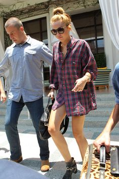"""Singer Miley Cyrus and her """"friend"""" Cheyne Thomas check out of their hotel in Miami, Florida on June 14, 2012. Cheyne spent a few minutes in the morning enjoying the view from the balcony. Miley has already taken to Twitter to deny deny that she's cheating on her fiance Liam Hemsworth with Thomas, saying """"I love my fiance and he loves me."""