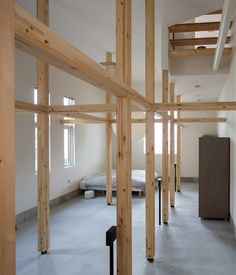 The wooden framework of this Japanese house will allow the owners to adapt the lower floor into a photography studio or children's room