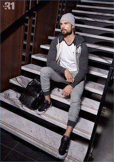 Going sporty, Walter Savage wears a hoodie, joggers, and tee by Reebok.