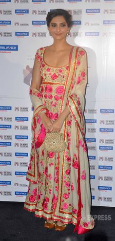 Sonam Kapoor in a floral embroidered floor length anarkali and a mini Dolce & Gabbana Miss Sicily bag