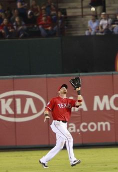 APRIL 10: Josh Hamilton #32 of the Texas Rangers catches a pop up by Chone Figgins #9 of the Seattle Mariners at Rangers Ballpark in Arlington on April 10, 2012 in Arlington, Texas. (Photo by Rick Yeatts/Getty Images)