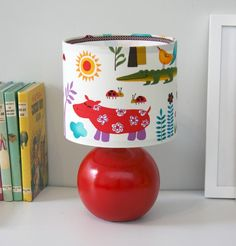 Fabric covered childrens lamp. No instructions but good inspiration. Use other diy lampshade instructions.
