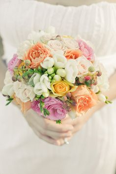 Oranges, pinks and yellows mixed with white would make such a lovely palette for a beach wedding