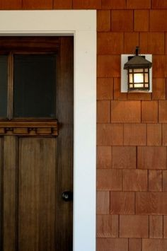lovely. Craftsman door, cedar shakes.