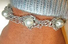 Crochet Pattern: Cupped Bauble Bracelet. This wire bracelet has a cool and sophisticated look when made with pearls, and the wire crochet gives it an interesting texture.