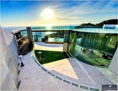 The unparalleled geometric presence of this incredible 11,000 sq. ft. translucent glass pavilion luxury home is set high on a cliff overlooking the Pacific Ocean in the La Jolla community of San Diego, California.