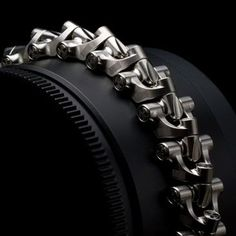 """Rogue Breacher™ Product: Limited Edition Bracelet Material: Mil-Spec G5 Aerospace-Grade Titanium Processes: 5-axis machined from billet block, etching Finish: Zero hand finishing / Calculated tool-paths Dimensions: LINK WIDTH: 24mm (0.94""""), LINK HIEGHT: 12.69mm (0.49"""")"""