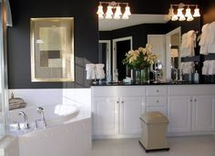 Pulte Design Tip: Dark walls to contrast light flooring and cabinets give this bathroom a modern, glamorous feel. | Pulte Homes