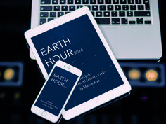 "Event announcement advertisement on iPhone & iPad which about the Earth Hour to reduce the use of the light for some minutes. ""https://www.behance.net/gallery/25134723/Free-PSD-Mockups-7"""