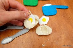 little felt eggs come out of the shells! Would be great for a kitchen or food themed page in a quiet book