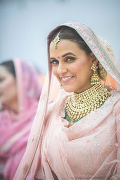 In the intimate and pretty wedding of Neha Dhupia she was giving us a major bridal goals. After the wedding Neha and Angad left for the US for vacation. Indian Wedding Jewelry, Indian Bridal, Indian Weddings, Indian Jewelry, Bridal Makeup Looks, Bridal Looks, Bollywood Bridal, Bollywood Jewelry, Bridal Lehenga Choli