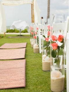 Budget-Friendly Wedding Ideas: Line the aisle with flowers, terrarium-style     A fun way to dress up the aisle: Simply put a smaller vase filled with water for the flowers inside of a larger vase weighed down with sand, pebbles, or coffee beans.
