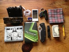 My 16 year old son Joshua's EDC! Camo Multitool, iPod Nano, XTAR LED keychain light, GoingGear battery case filed with parafin wax impregnated cotton balls and a ferro rod, vintage hanky, Wallet, pocket New Testament, Spyderco Tenacious, Maratac AAA flash light, Loot and a pencil.