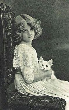 beautiful young girl, holding white cat