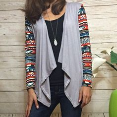 Grey Sweater with Patterned Sleeves Cute and comfy sweater. No pockets, ties, zips, or buttons. Meant to just hang and be worn open. Longer in the front and shorter in the back. I am 5'3 and a size 2. This item is available. Ask me about bundle discounts! Sweaters Cardigans