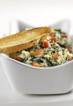 One of Skinny Mom's most famous Italian appetizer is the Skinny Spinach Artichoke Dip! If you want a crowd pleaser recipe then re-pin to blow your taste buds away!