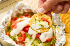 Caprese Dip hot off the grill or out of the oven for Tailgating Snacks Month! Dig in to this cheese filled dip with tomatoes and basil!