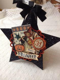 Large star Halloween decoration that is completely hand crafted from heavyweight card stock, heavily glittered with black chunk glitter and decorated