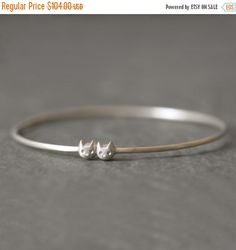 Hey, I found this really awesome Etsy listing at https://www.etsy.com/listing/62035169/on-sale-kitty-bangle-in-sterling-silver