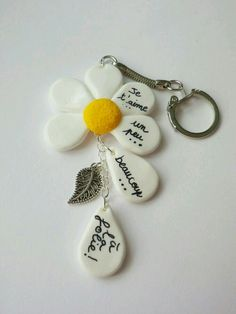 He loves me...he loves me not...Cute daisy flower key chain for inspiration. I bet it was made from polymer clay.