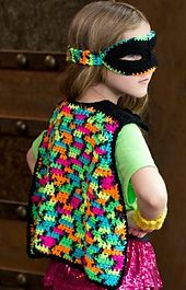 What a super way to use neon Super Saver colors! This fun outfit includes crocheted mask, cape, cuffs for the wrists and stars to use on a t-shirt or on whatever needs a bit of brightness.