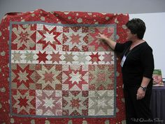 Gerri Robinson showing off quilts from her new book, A Cut Above.