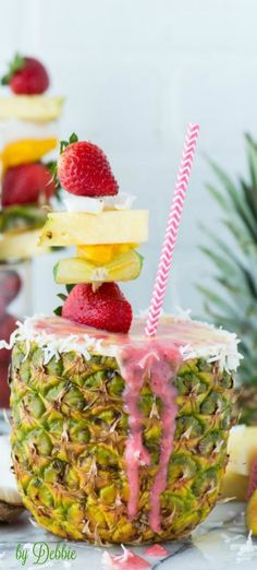 Pineapple Strawberry Smoothie ~  Debbie ❤ http://thefirstyearblog.com/pineapple-strawberry-smoothie-in-pineapple-cup/