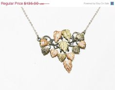Black Hills Gold Leaf Pendant and Silvertone by thejewelseeker