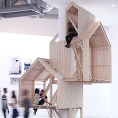 These tree house-like cabins are built up around the column of a building rather than over the branches of a tree.