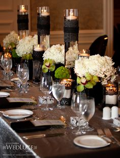 Black, white, green table setting. Very elegant.