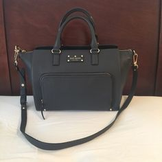 Kate Spade Large NWT Perfect for those that like big bags! It holds a ton! The pocket in the front is large enough for a large wallet.   12in long (measured from the bottom across)  16in long (measured from top across)  7in wide  9in bag depth   No dust bag    It's a lighter color black, but still black. kate spade Bags Satchels