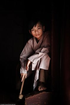 Andrew Linscott's portrait is of a novice monk, going through his training, in Northern Vietnam