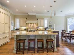 Naples Hot Property Blog - Island seating - eat in kitchen - gas range - hidden fridge.  il Regalo | North Naples, Florida