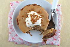 Martha Stewart's Gingerbread Cheesecake baked on a gingersnap crust and laced with rich, warm spices like ginger, cloves, nutmeg and cinnamon.