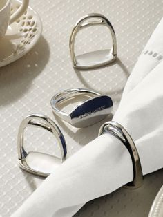 """Derbyshire Napkin Ring Set - Ralph Lauren Home Serving Pieces - RalphLauren.com $105 This handsome set contains four equestrian-inspired napkin rings that are crafted from polished silver-plated brass. 2"""" diameter. 2?"""" height. Imported."""