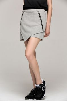 <p>Grey over hip mini-skirt; two pieces in the front overlaid; irregular sense conveys sports style; zipper in the front, used as pocket when unzipped; elastic fabric.. Shell: 100% cotton; lining: 67% polyester fiber, 29% viscose, 4% spandex</p>