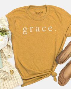 Grace tshirt on a mustard color tee, super soft and comfy Christian Clothing, Christian Shirts, Diy Shirt, Shirt Shop, Stylish Shirts, Trendy Outfits, Vinyl Shirts, Shirts For Teens, Textiles