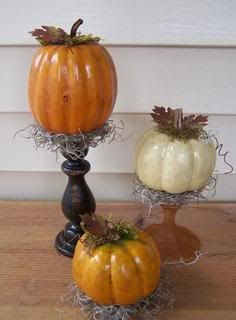 Primitive autumn decor: Dollar store has these pumpkins and glue to candle sticks..