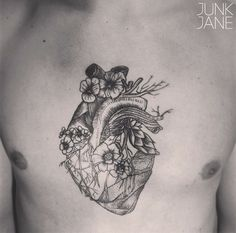 anatomical heart with flowers and twigs/ needs more balance on the right side but looks really beautiful. inspiring piece :)