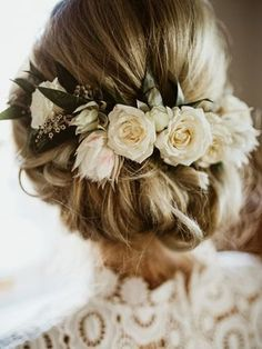 Wedding hairstyle low updo with flower crown. #weddinghairstyles