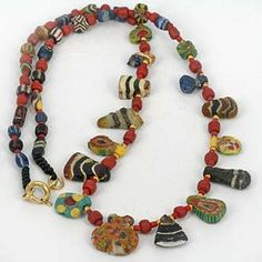 Knot worked necklace containing a unique collection of ancient glass & mosaic glass beads. Delicate miniature works of art history.